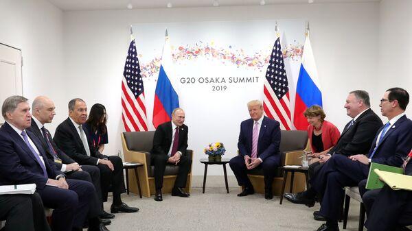 Delegations, led by Russia's President Vladimir Putin and U.S. President Donald Trump, hold talks on the sidelines of the G20 summit in Osaka, Japan June 28, 2019 - Sputnik International