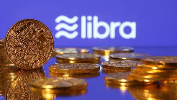 Representations of virtual currency are displayed in front of the Libra logo in this illustration picture, June 21, 2019 - Sputnik International