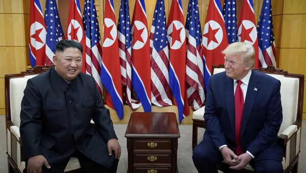 U.S. President Donald Trump meets with North Korean leader Kim Jong Un at the demilitarized zone separating the two Koreas, in Panmunjom, South Korea, June 30, 2019.  - Sputnik International
