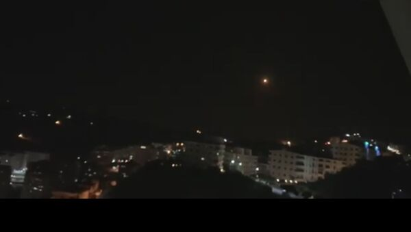 Snap from the video posted by SANA pictiring explosions over Damascus - Sputnik International