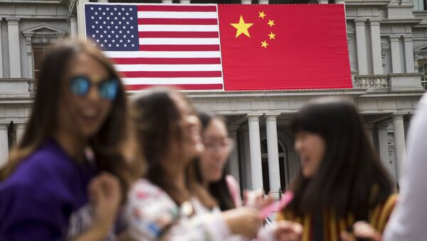 In this Thursday, Sept. 24, 2015, photo, China's flag is displayed next to the American flag on the side of the Old Executive Office Building on the White House complex in Washington, the day before a state visit by Chinese President Xi Jinping - Sputnik International