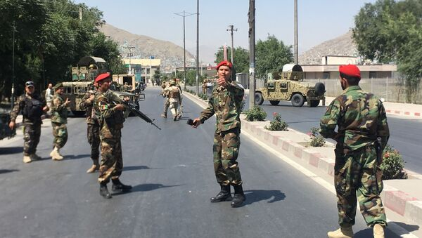 Afghan security forces arrive at the site of an explosion in Kabul, Afghanistan - Sputnik International