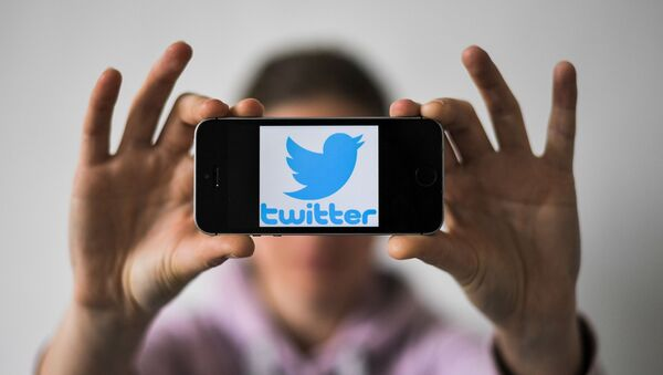 A woman holds a smartphone with the logo of US social network Twitter, on May 2, 2019 in Nantes, western France - Sputnik International