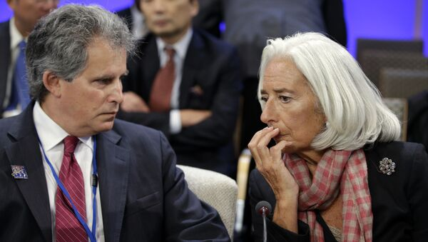 International Monetary Fund (IMF) Managing Director Christine Lagarde, right, speaks with First Deputy Managing Director of the International Monetary Fund, David Lipton - Sputnik International