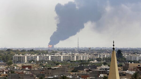 Black smoke billows over the skyline as a fire at the oil depot for the airport rages out of control after being struck in the crossfire of warring militias battling for control of the airfield, in Tripoli, - Sputnik International