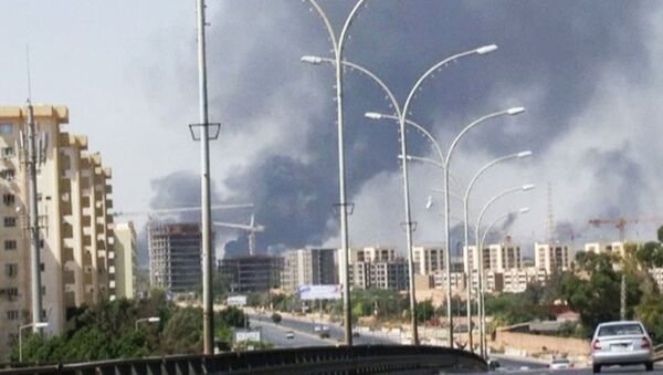 July 13, 2014 file image made from video by The Associated Press, smoke rises from the direction of Tripoli airport in Tripoli, Libya. - Sputnik International