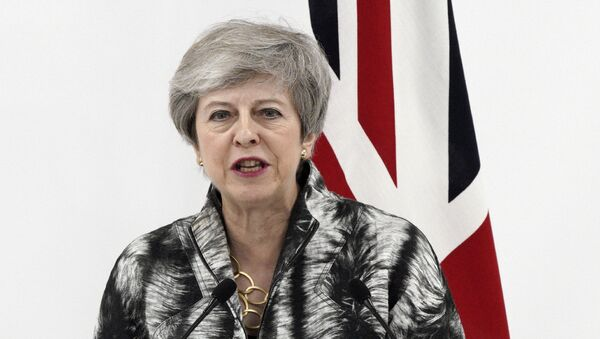 British Prime Minister Theresa May speaks during a press conference after the G-20 summit in Osaka, western Japan Saturday, June 29, 2019 - Sputnik International