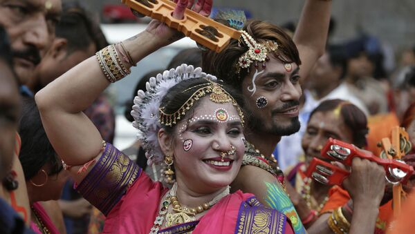 Indian Hindu devotees participate in the annual festival of Rath Yatra, or chariot procession, in Ahmadabad, India, Thursday, July 4, 2019 - Sputnik International