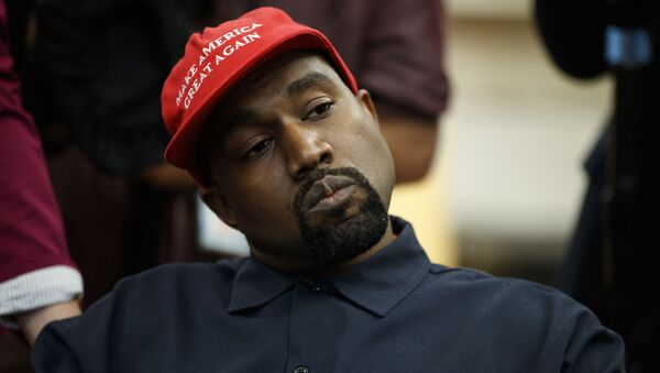 Rapper Kanye West listens to a question from a reporter during a meeting in the Oval Office of the White House with President Donald Trump, Thursday, Oct. 11, 2018, in Washington - Sputnik International