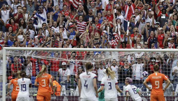 United States' Megan Rapinoe, 2nd right, celebrates with teammates after scoring her side's opening goal during the Women's World Cup final soccer match between US and The Netherlands at the Stade de Lyon in Decines - Sputnik International