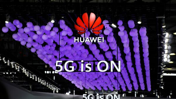 A Huawei logo and a 5G sign are pictured at Mobile World Congress (MWC) in Shanghai, China June 28, 2019 - Sputnik International