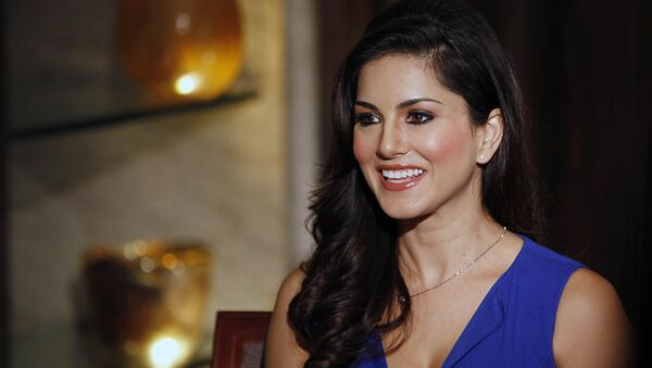 """In this Sunday, 29 July 2012 photo, hard-core porn actress Sunny Leone, who stars in Bollywood film """"Jism 2"""" speaks to media in Mumbai, India. The film, which will be released across India on Friday, is pushing the ever-widening sexual boundaries enjoyed by many in urban India. - Sputnik International"""