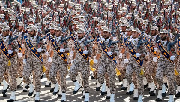 Members of Iran's Revolutionary Guards Corps (IRGC) march during the annual military parade marking the anniversary of the outbreak of the devastating 1980-1988 war with Saddam Hussein's Iraq, in the capital Tehran on September 22, 2018 - Sputnik International