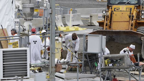 In this March 6, 2013 file photo, workers are shown at the 'C' Tank Farm at the Hanford Nuclear Reservation, near Richland, Wash. Conservation groups are alarmed by the Trump administration's proposal to rename some radioactive waste left from the production of nuclear weapons to make it cheaper and easier to achieve permanent disposal.  - Sputnik International