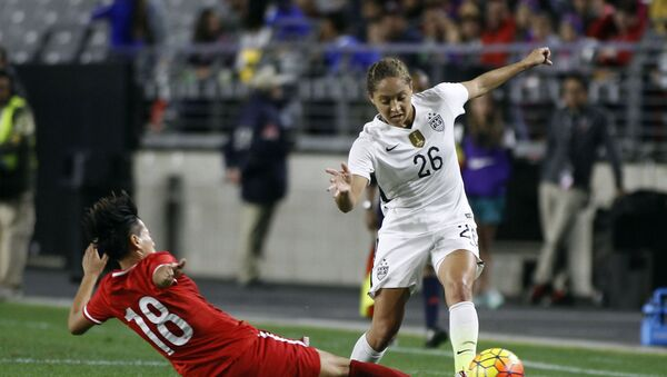 FILE - In this Dec. 13, 2015, file photo, China's Han Peng (18) slides in to knock the ball away from United States' Jaelene Hinkle during the second half of an international friendly soccer match, in Glendale, Ariz - Sputnik International