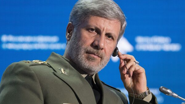 Iranian Defense Minister Amir Hatami listens during the Conference on International Security in Moscow, Russia, Wednesday, April 4, 2018 - Sputnik International