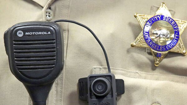This Sept. 22, 2014 file photo shows a body camera on the uniform of a Los Angeles County Sheriff's deputy at department headquarters in Monterey Park, Calif. - Sputnik International