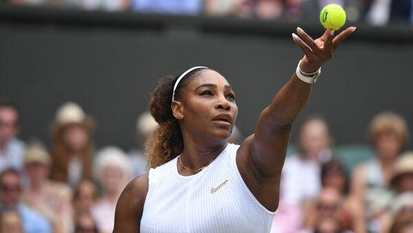 US player Serena Williams serves against Romania's Simona Halep during their women's singles final on day twelve of the 2019 Wimbledon Championships - Sputnik International