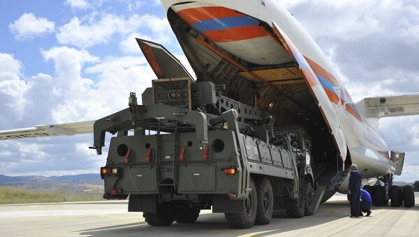 Military vehicles and equipment, parts of the S-400 air defense systems, are unloaded from a Russian transport aircraft, at Murted military airport in Ankara, Turkey, Friday, July 12, 2019 - Sputnik International