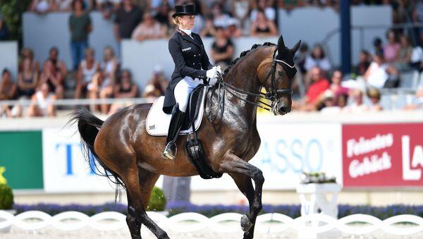 German dressage rider Jessica von Bredow-Werndl on her horse Dalera competes during the World Equestrian Festival CHIO in Aachen Germany on July 21, 2018 - Sputnik International