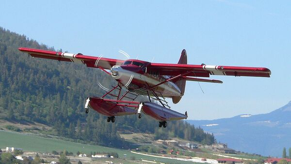 This April 29, 2005 photo released by John Olafson, shows an aircraft with tail number N455A, leaving Vernon, British Columbia, Canada and headed to Alaska. - Sputnik International
