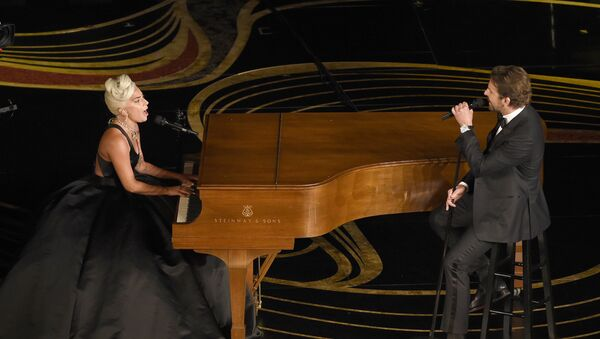 Lady Gaga, left, and Bradley Cooper perform Shallow from A Star is Born at the Oscars on Sunday, Feb. 24, 2019, at the Dolby Theatre in Los Angeles - Sputnik International