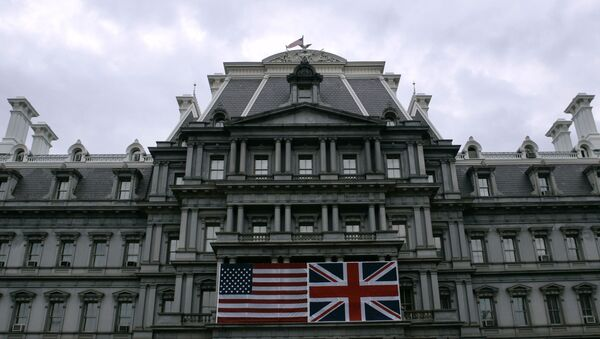 Flags of the United States and the United Kingdom are displayed in front of the Old Executive Office Building - Sputnik International