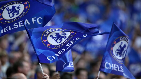 Cheslea supporters wave flags in the crowd ahead of the English FA Community Shield football match between Arsenal and Chelsea at Wembley Stadium - Sputnik International