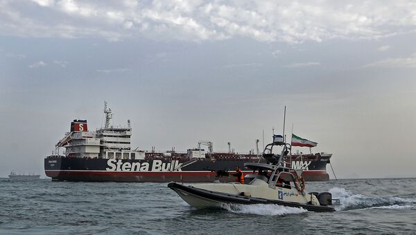 A picture taken on July 21, 2019, shows Iranian Revolutionary Guards patrolling around the British-flagged tanker Stena Impero as it's anchored off the Iranian port city of Bandar Abbas. - Sputnik International