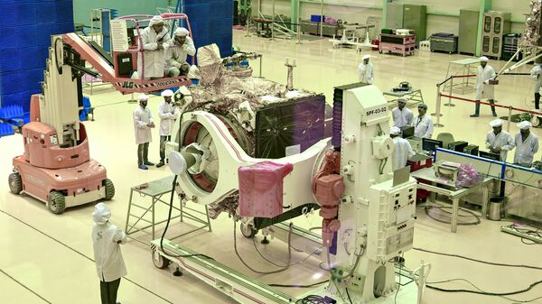 (FILES) In this file photo taken on June 12, 2019, Indian Space Research Organisation (ISRO) scientists work on the orbiter vehicle of 'Chandrayaan-2' - Sputnik International