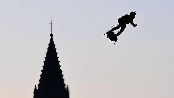 Zapata CEO Franky Zapata flies a jet-powered hoverboard or Flyboard over the old harbour as part of  Bastille Day celebrations in Marseille on July 14, 2019. - Sputnik International