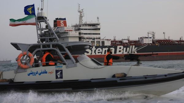 A boat of Iranian Revolutionary Guard sails next to Stena Impero, a British-flagged vessel owned by Stena Bulk, at Bandar Abbas port, in this undated handout photo - Sputnik International