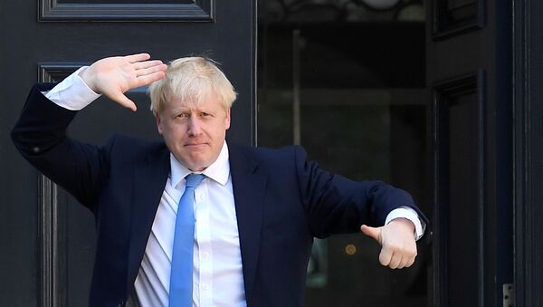 Boris Johnson gestures as he arrives at the Conservative Party headquarters, after being announced as Britain's next Prime Minister, in London, Britain July 23, 2019 - Sputnik International