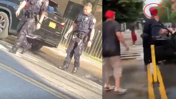 NYPD Officers seen soaked after civilians douse them with water over the weekend of 7/19-7/23 - Sputnik International