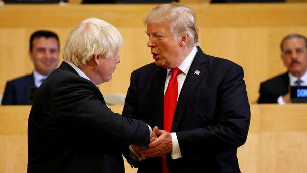 U.S. President Donald Trump shakes hands with British Foreign Secretary Boris Johnson as they take part in a session on reforming the United Nations at U.N. Headquarters in New York - Sputnik International