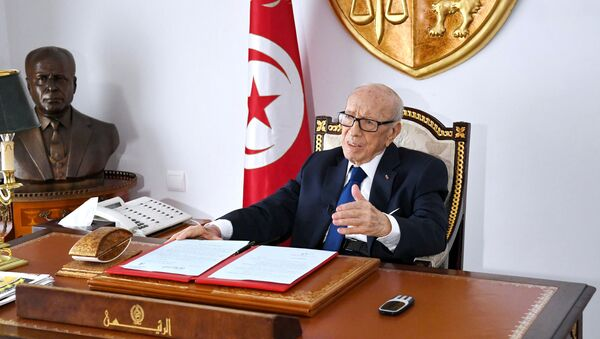 Tunisian President Beji Caid Essebsi sits at his desk at the Carthage Palace, in this handout picture obtained by Reuters on July 5, 2019, in Tunis, Tunisia - Sputnik International