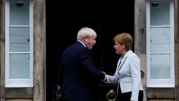 Britain's Prime Minister Boris Johnson shakes hands with Scotland's First Minister Nicola Sturgeon at Bute House in Edinburgh, Scotland, Britain July 29, 2019. - Sputnik International