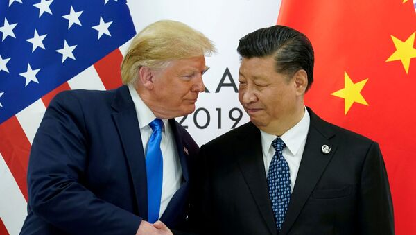 U.S. President Donald Trump meets with China's President Xi Jinping at the start of their bilateral meeting at the G20 leaders summit in Osaka, Japan, June 29, 2019 - Sputnik International