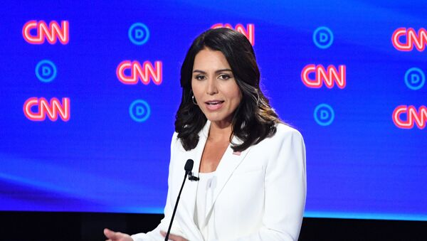 Democratic presidential hopeful US Representative for Hawaii's 2nd congressional district Tulsi Gabbard speaks during the second round of the second Democratic primary debate of the 2020 presidential campaign season hosted by CNN at the Fox Theatre in Detroit, Michigan on July 31, 2019.  - Sputnik International