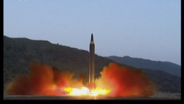 In this image made from video of a news bulletin aired by North Korea's KRT on Monday, May 15, 2017, shows what was said to be the launch of the Hwasong-12 missile at an undisclosed location in North Korea. - Sputnik International