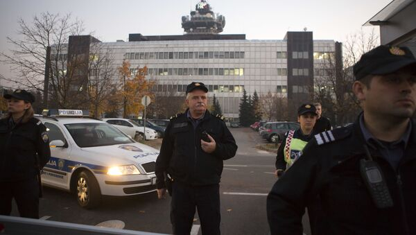 Police secure the building of state TV as members and supporters of of Zivi Zid political party rally in Zagreb, Croatia, Friday, Nov. 6, 2015. - Sputnik International