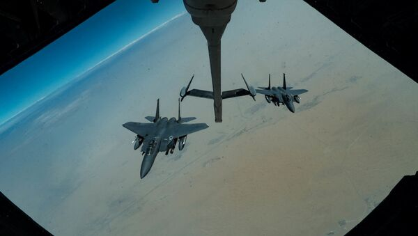F-15E Strike Eagles assigned to the 336th Expeditionary Fighter Squadron approaches a KC-10 Extender for refuelling, at an undisclosed location in Gulf, during a surface combat air patrol mission, in this undated handout picture released by U.S. Air Force on June 27, 2019 - Sputnik International