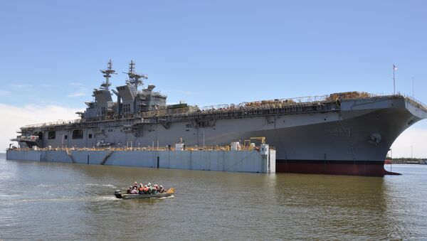 PASCAGOULA, Miss. (May 1, 2017) The future USS Tripoli (LHA 7) is launched at Huntington Ingalls Industries. Tripoli was successfully launched after the dry-dock was flooded to allow it to float off for the first time. Tripoli incorporates an enlarged hangar deck, enhanced maintenance facilities, increased fuel capacity and additional storerooms to provide the fleet with a platform optimized for aviation capabilities. The ship is planned to be christened in 2017 with delivery planned for late 2018 - Sputnik International