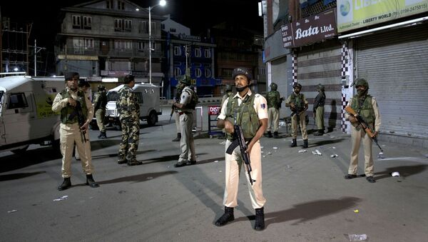 Indian soldiers stand guard in Srinagar, India, Sunday, Aug. 4, 2019. Tensions have soared along the volatile, highly militarized frontier between India and Pakistan in the disputed Himalayan region of Kashmir, as India has deployed more troops and ordered thousands of visitors out of the region - Sputnik International