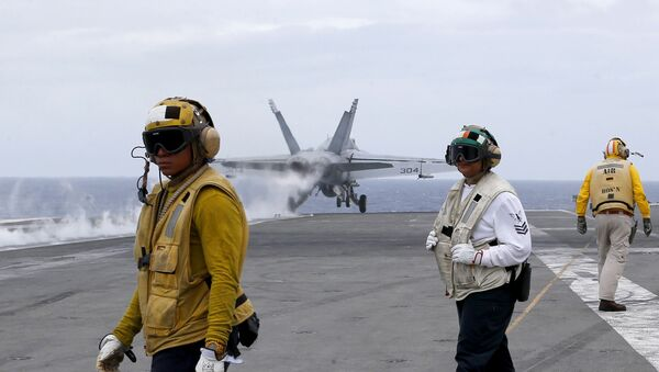 A U.S. fighter jet takes off from the U.S. aircraft carrier USS Ronald Reagan for their patrol at the international waters off South China Sea Tuesday, Aug. 6, 2019 - Sputnik International