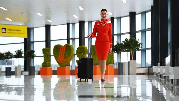 Aeroflot's flight attendant Anastasia Belousova at Sheremetyevo Airport - Sputnik International