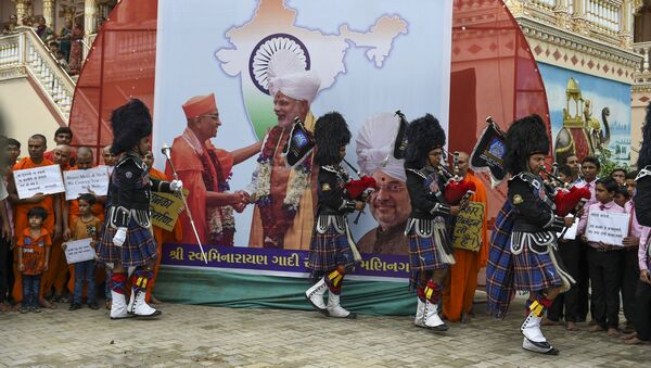Pipe band members of the lord Shree Muktajivan Swamibapa perform as they participate in celebrations after the Indian government has revoked special autonomy to Indian-administered Kashmir, at the spiritual centre 'Maninagar Shree Swaminarayan Gadi Sansthan' in Ahmedabad, on August 6, 2019 - Sputnik International