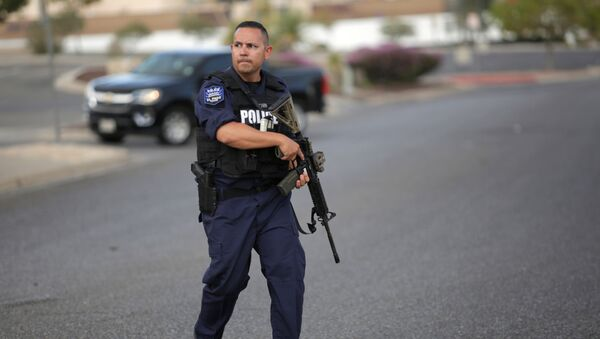 A police officer is seen after a mass shooting at a Walmart in El Paso, Texas, U.S. August 3, 2019. - Sputnik International