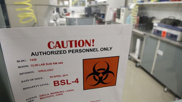 A sign on the door of a Biosafety Level 4 laboratory at the U.S. Army Medical Research Institute of Infectious Diseases in Fort Detrick, Md., Wednesday, Aug. 10, 2011. - Sputnik International