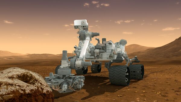 This artist's concept features NASA's Mars Science Laboratory Curiosity rover, a mobile robot for investigating Mars' past or present ability to sustain microbial life. Curiosity landed near the Martian equator about 10:31 p.m., Aug. 5 PDT - Sputnik International